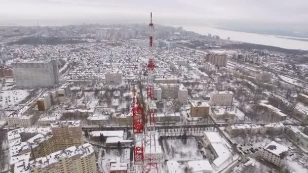 around aerial flying shot of tv tower in winter day, Samara city