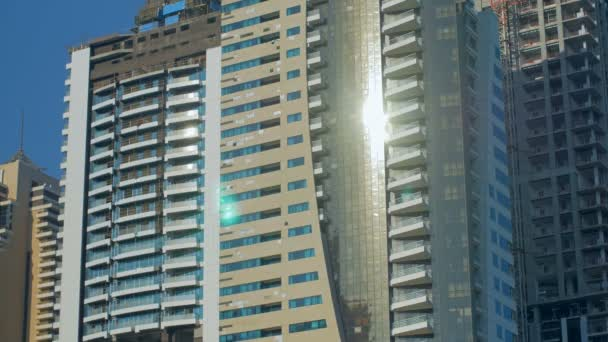 facades of modern high buildings made from concrete and glass with reflection