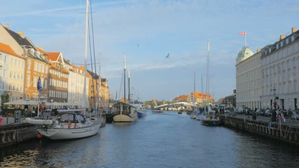 calm sunny evening in Copenhagen, view at centre of one of a bridge of Nyhavn- new harbour
