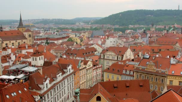 static shot of amazing view of Prague city in summer from top, red roofs