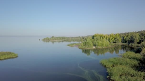 aerial view on calm landscape with lakes, river, forest and sandy coasts in sunny morning