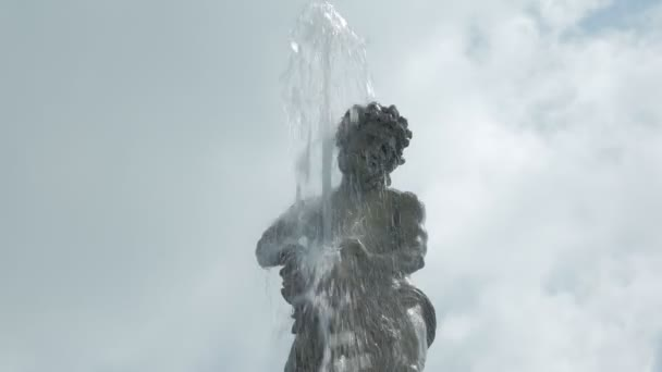 fountain flow is pouring from statue of human, ancient architectural art
