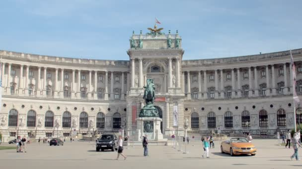 people are walking in front majestic palace in Vienna, Austria, sunny sumer day