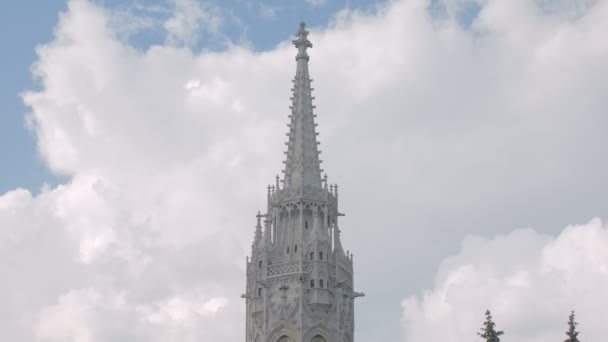 close-up view on top of white stone tower of ancient neo gothic style building in european city