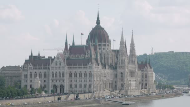 majestic building of Hungarian Parliament in Budapest on Danube bank in twilight time