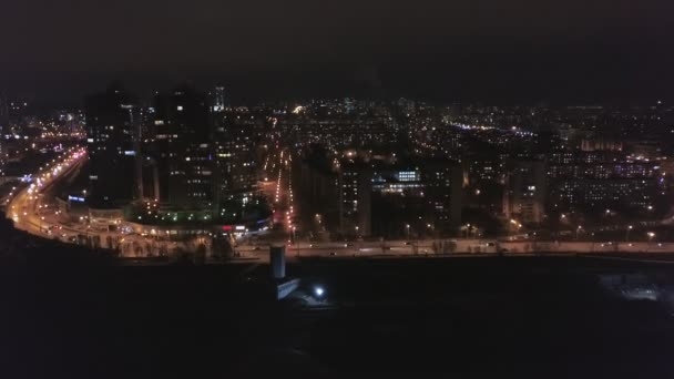 night aerial view on panorama of amazing megapolis with lights in windows of high buildings