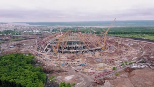 large modern stadium under construction in background panorama of modern city in summer day