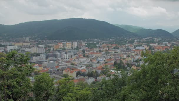 top view on small austrian town in mountains in cloudy weather