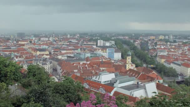 storm is moving over Graz city in Austria in spring time, view from mountain, cityscape