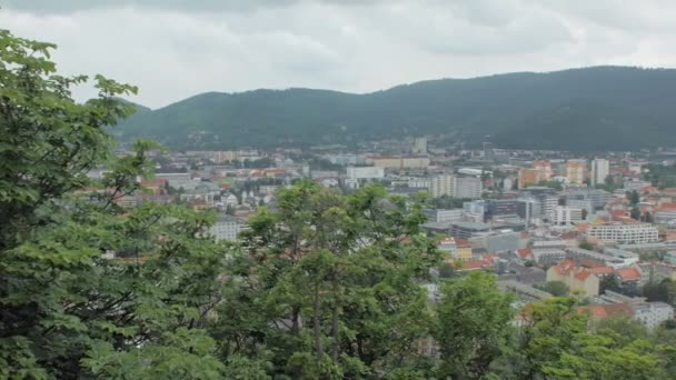 panorama of small city in cloudy day in spring, between mountains