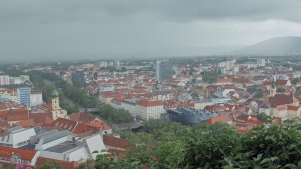 panoramic moving view on austrian Graz city from castle hill with the clock tower Uhrturm