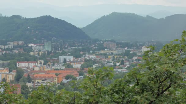 amazing view on small city between mountains in summer day, cloudy