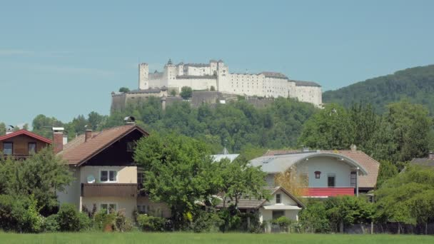 famous Hohensalzburg Fortress on top of the Festungsberg mountain in Salzburg in sunny summer day