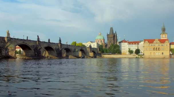 famous medieval Charles Bridge and water of Vltava river in Prague in spring day
