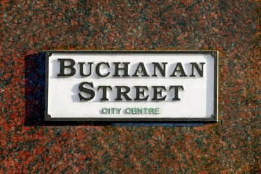 Buchanan Street sign on a marble clad building in Glasgow.