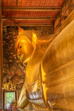 The Reclining Buddha at the Wat Pho temple complex in the Bangkok.  The Buddha that measures 46 metres long and is covered in gold leaf.