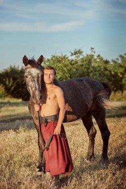 Cossack and his horse. Ukraine. Zaporozhye Sech.