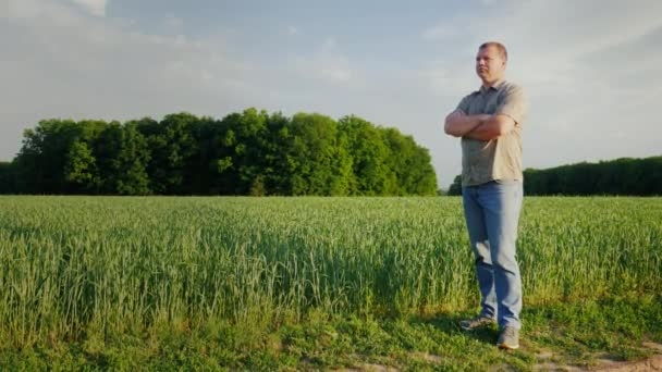 Middle-aged self-confident farmer examines his field. Full-length person. The owner of a small business concept