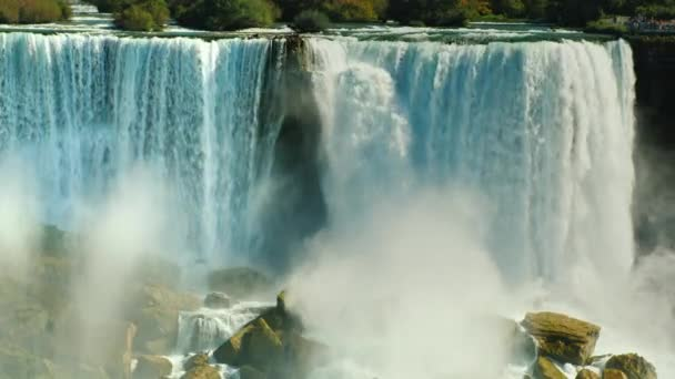 4k video: Cascade of incredible waterfalls - Niagara Falls. Telephoto view from the Canadian side to the American coast
