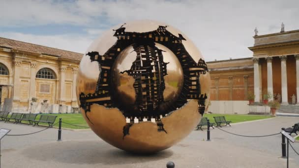 ROME, ITALY, VATICAN - JUNE, 2017: The Sphere within a Sphere, a bronze sculpture. Steadicam shot