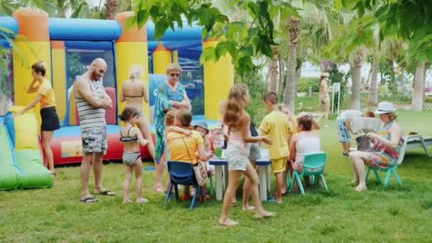 Kemer, Turkey, June 2018: The entertainment team plays with children in a Turkish hotel. Nearby Their parents are watching the games