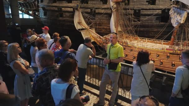 Stockholm, Sweden, July 2018: The guide tells visitors the history of the sunken ship Vasa. An amazing ship that has survived to our days, raised from the bottom of the sea