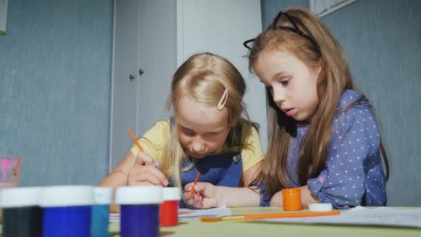 Children paint together with watercolors