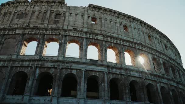 Sunset through the arches of the Coliseum