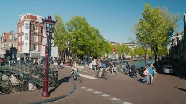 Amesterdam, Netherlands, May 2018: TA picturesque intersection with a bridge with heavy traffic of bicycles. The most popular transport in Amsterdam