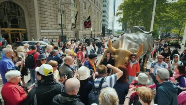 New York, USA, October 2018: The statue of an Charging Bull , also known as a bull on Wall Street, depicts a powerful, enraged bull preparing to attack