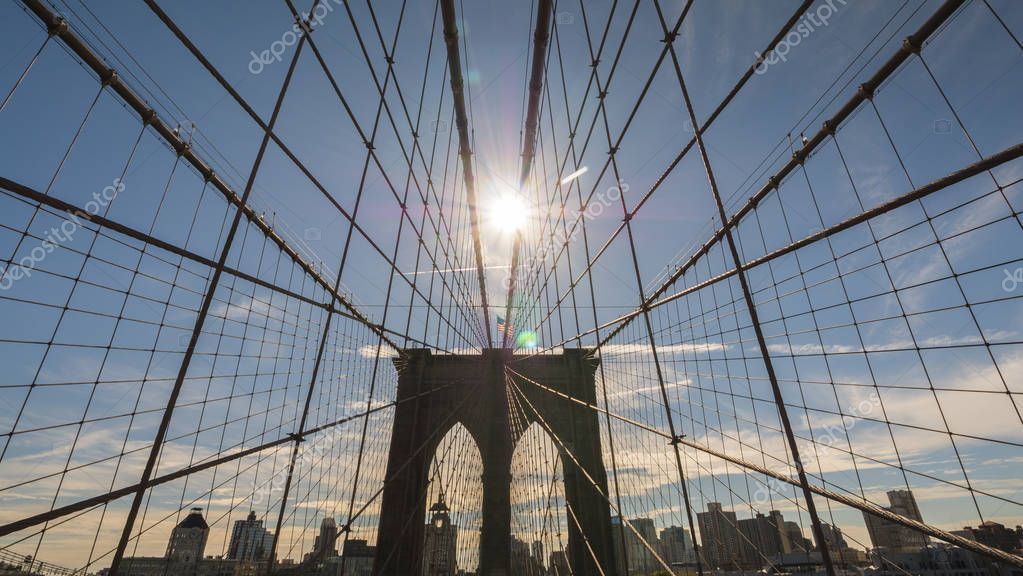 The sun shines over the Brooklyn Bridge in New York
