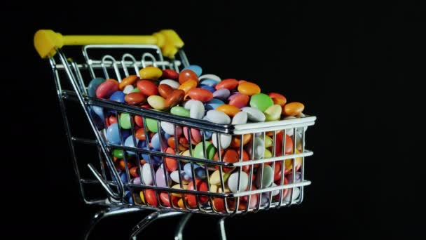 Small shopping cart with multi-colored candies