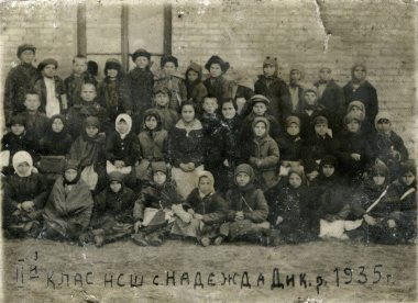 Poltava, Ukrrane, circa 1935: Group photo of the elementary school elementary school in the Soviet Union. Below the name of the village in Ukraine, Poltava region and the inscription Our class