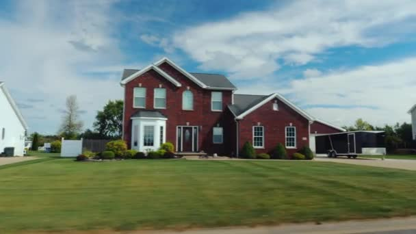 Drive along typical American suburbs - well-groomed lawns and houses