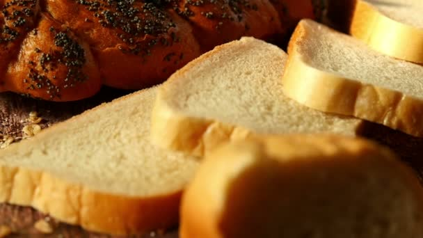 Composition of fresh pastries on a wooden background. Bread, bun, bakery. Agriculture and bakery.