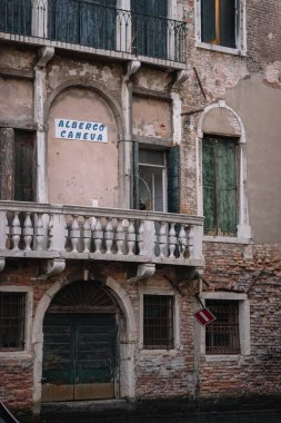 Venice, Italy - August 13, 2016: Facade of the old building of the Caneva Hotel in Venice, Italy.