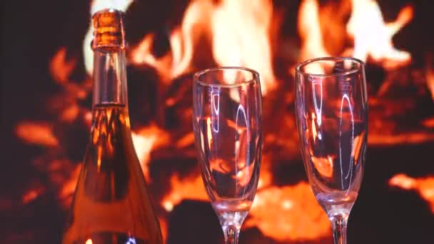 Two glasses of sparkling champagne in front of warm fireplace. C. Christmas, collection, valentines day