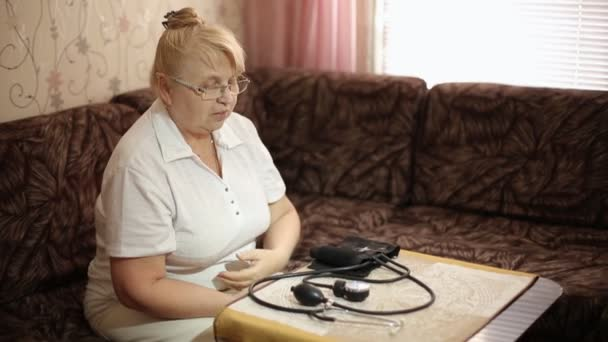 adult woman measuring blood pressure. Health care in adulthood
