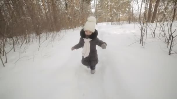 little three-year-old girl running in the winter Park