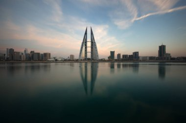 MANAMA, BAHRAIN - FEBRUARY 05: The Bahrain World Trade Center during dusk, a twin tower complex is the first skyscraper in the world to have wind turbines, photographed on February 05, 2018, Manama, Bahrain