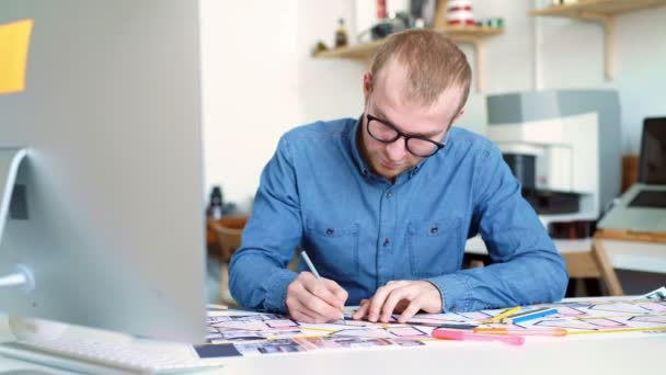 Hipster architect working from home, sketching a housing project