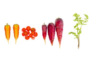 Pieces of colorful raw carrots on white background