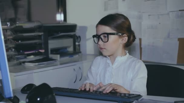 Cute girl puts on glasses and works with computer with smile. 4K