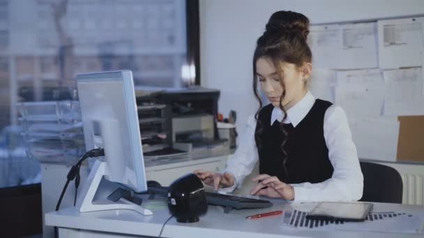Young office girl working with pc and tablet. 4K ⬇ Video by © pro100Pasha Stock Footage #200027566