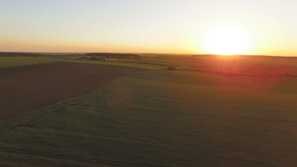 Aerial view of amazing big, colourful sunset among countryside