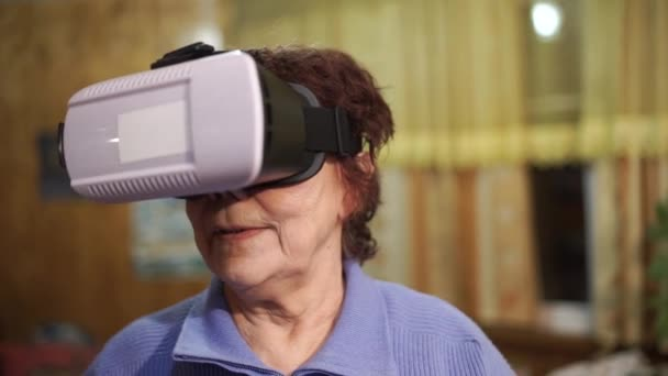 Close-up of grandmother using virtual reality headset, VR mask