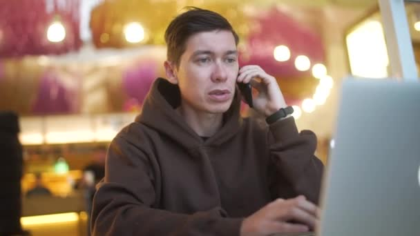 Young hipster fashion man working on laptop in coffee shop