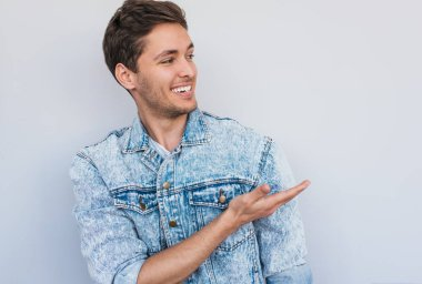 portrait of young smiling male model wearing trendy jeans jacket