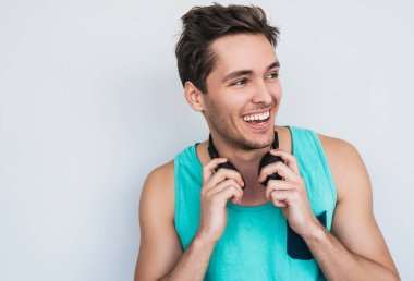 handsome man wearing colorful hipster tank top