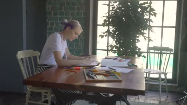 Young fashion woman designer drawing design sketch working in her manufacturing office studio. profession and job occupation concept.